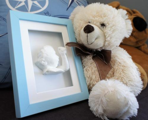 Blue Shadow box frame with White statue 15 x 20 Bear